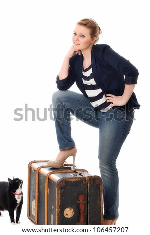 Pretty young woman ready to leave home - stock photo