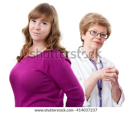 Pretty young woman standing in front of elder doctor, looking at camera and smiling, isolated on white background - stock photo