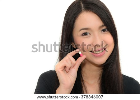 pretty young woman taking pills - stock photo