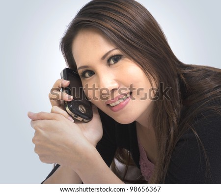 pretty young woman talking a cellphone with smiling - stock photo
