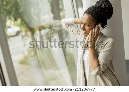 Pretty young woman talking on the phone - stock photo