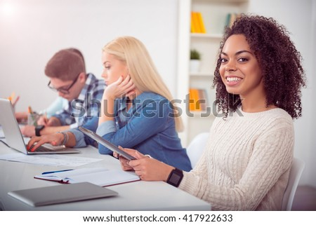 Pretty young woman using the tablet - stock photo