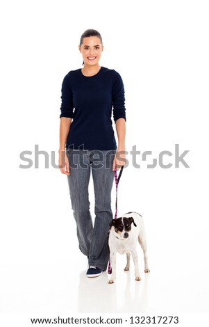 pretty young woman walking with her dog isolated on white - stock photo