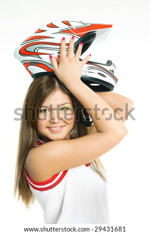 pretty young woman wearing a motorcycle helmet, isolated against white background - stock photo