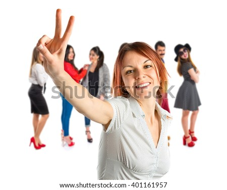 Pretty young woman winner over isolated white background  - stock photo