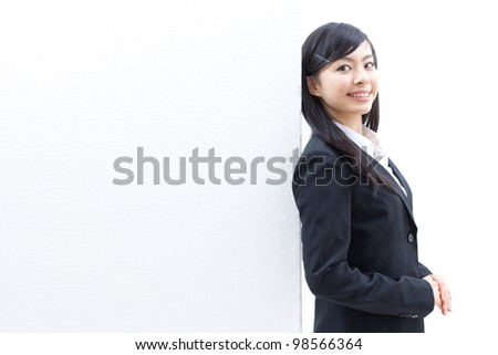 Pretty young woman with a blank presentation board - stock photo
