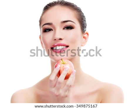 Pretty young woman with a red apple, isolated on white - stock photo