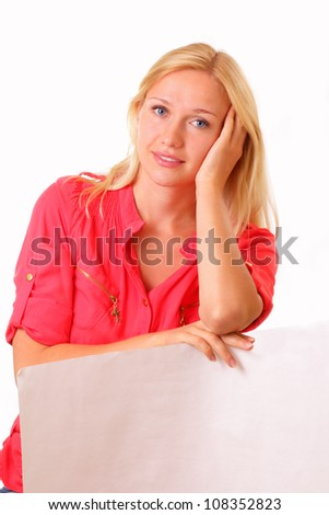 Pretty young woman with a sheet of paper - stock photo