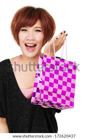 Pretty young woman with bags - stock photo