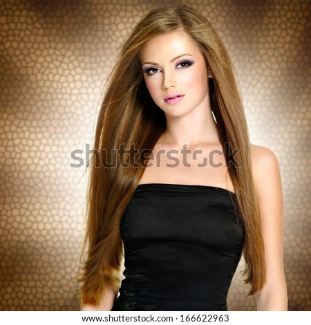 Pretty young woman with beautiful long straight  hair and attractive face - stock photo