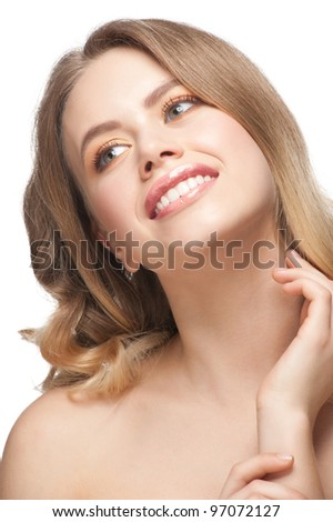Pretty young woman with beautiful make-up and perfect healthy skin touching her face. Isolated on white background - stock photo