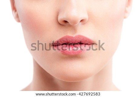Pretty young woman with healthy smooth skin - stock photo