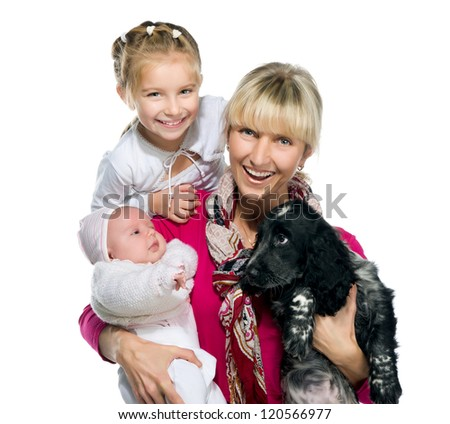Pretty young woman with her daughters and dog on a white background - stock photo
