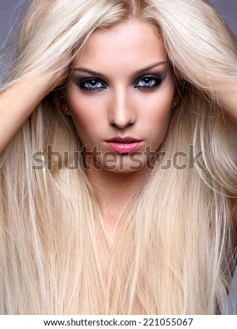 Pretty young woman with luxuriant long blond hair - stock photo