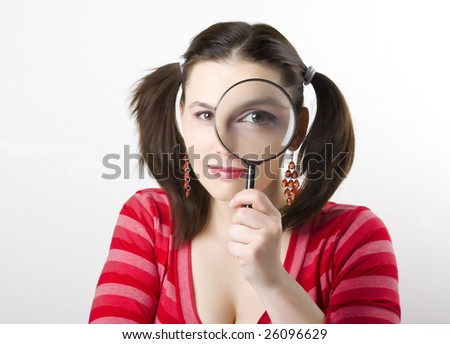 pretty young woman with magnifying - stock photo