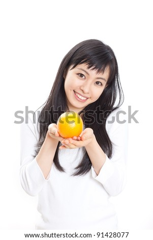 Pretty young woman with orange isolated on white background - stock photo