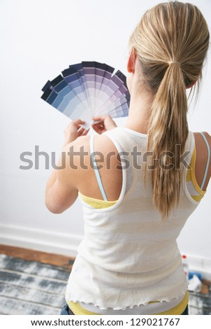 Pretty young woman with painting - stock photo