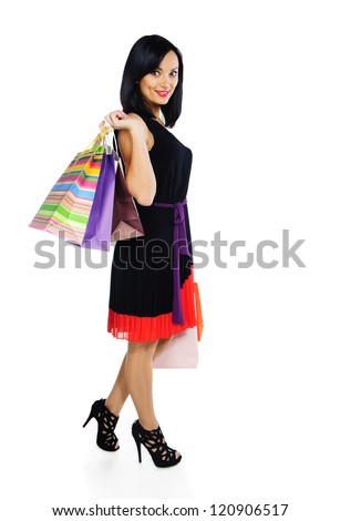 Pretty young woman with shopping bags isolated on white - stock photo