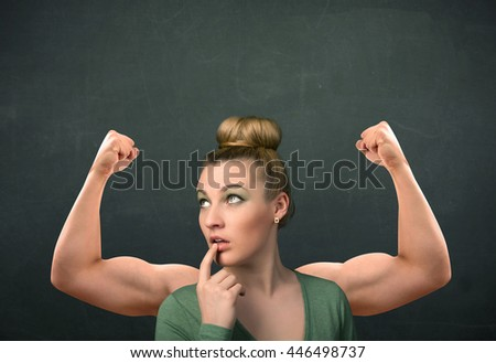 Pretty young woman with strong and muscled arms concept - stock photo