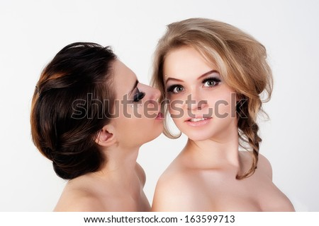 Pretty young women. One gossip other some message. - stock photo