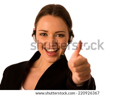 Prety happy asian caucasian business woman with headset showing thumb up as a gesture for success isolated - stock photo