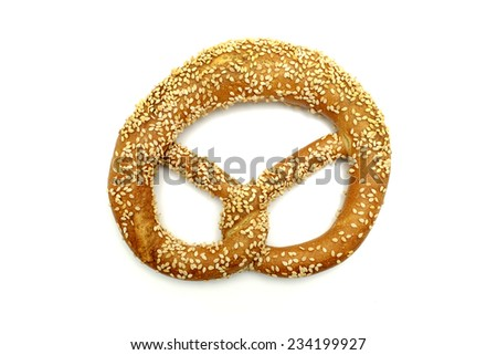 Pretzel with sesame seeds on a white background - stock photo