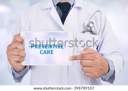 PREVENTIVE CARE  Doctor holding  digital tablet - stock photo