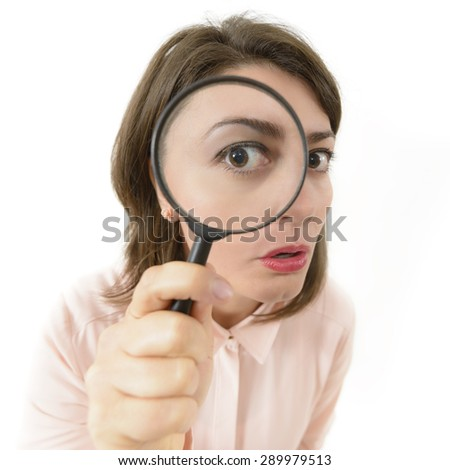 Price Cut Hunting, woman looking through an eyeglass - stock photo