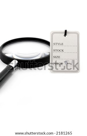 price tag and magnifier, the concept of finding a bargain - stock photo
