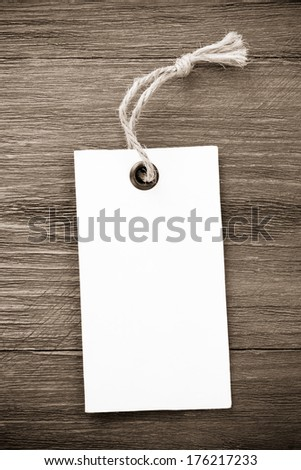 price tag label on wooden background - stock photo