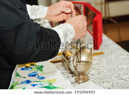 Priest during a ceremony - stock photo