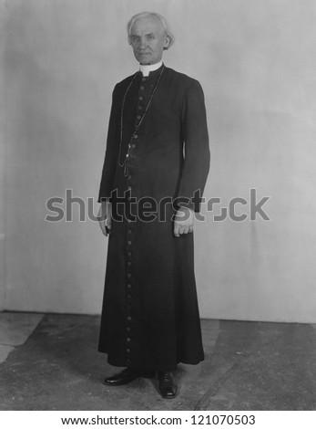 Priest in cassock - stock photo