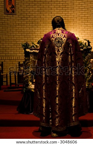 priest in the altar reading from the holly bible - stock photo