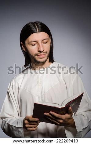 Priest man in religious concept - stock photo