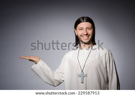 Priest man in religious concept - stock photo