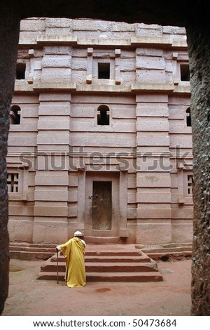 Priest outside the rock hewn church of Bet Amanuel at Laibela in Ethiopia - stock photo