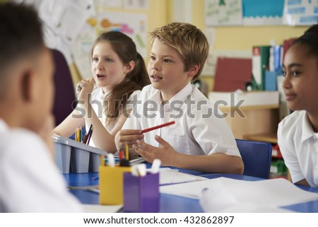 Primary school children work together in class, close up - stock photo