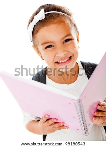 Primary school girl holding a notebook - isolated over a white background - stock photo