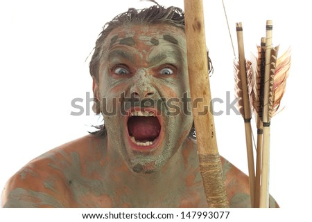 primitive man doing fierce facial expressions  - stock photo