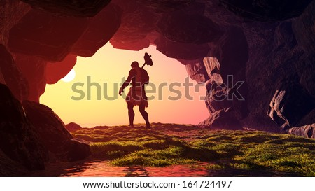 Primitive man in the cave. - stock photo
