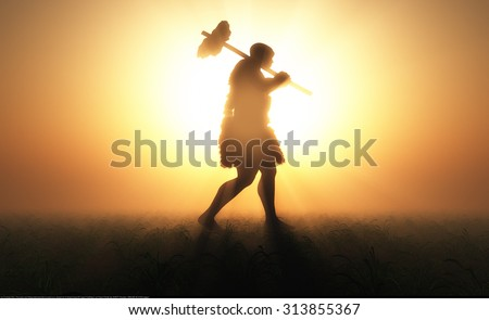 Primitive man silhouette against the sun. - stock photo