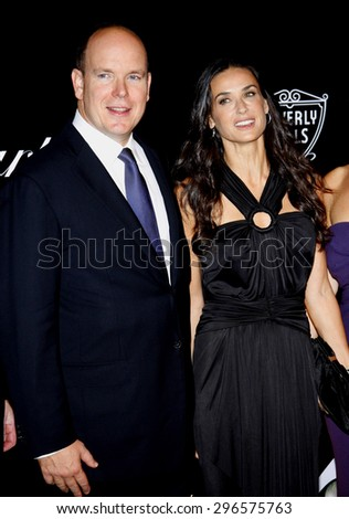 Prince Albert II of Monaco and Demi Moore at the Rodeo Drive Walk of Style Award honoring Princess Grace Kelly of Monaco and Cartier in Beverly Hills on October 22, 2009. - stock photo