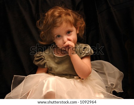 Princess Sucks Her Thumb - stock photo