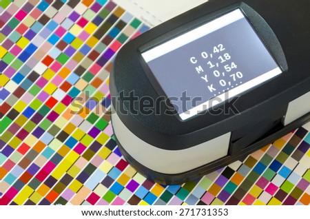 Print Spectrophotometer color measurement. Press offset color management cmyk values.  - stock photo