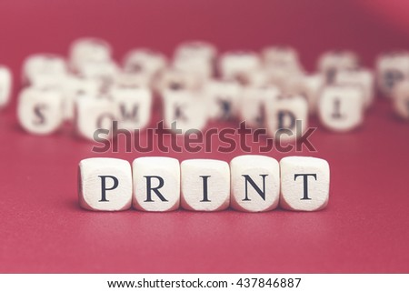Print word written on wood cube with red background - stock photo