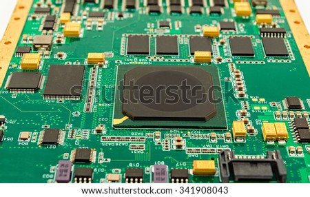 Printed circuit board (PCB) with microprocessor and other components - stock photo