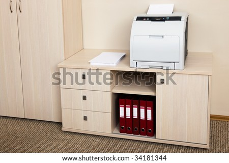 printer from the cabinet in a modern office - stock photo