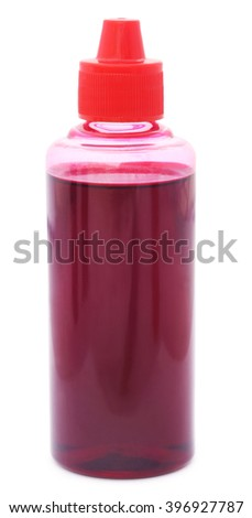 Printer ink bottle of magenta color over white background - stock photo