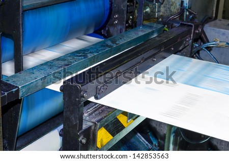 Printing machine, hit set speed roto offset print press, newspaper and magazine production industry - stock photo