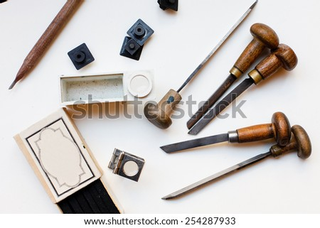 Printing press tools, arranged on a white background - stock photo
